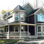 Two Story Victorian Home Covered Porch And Turret Roof